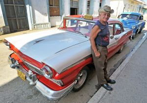 Trinidad - Ford Fairlane and cowboy driver 2 - Cuba