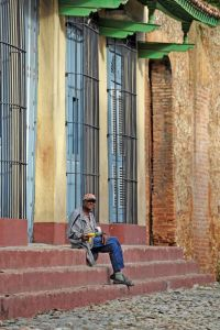 Trinidad - old town - old man on steps - Cuba