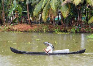 India, Kerala, Cochin, waterways rainswept canoe 3