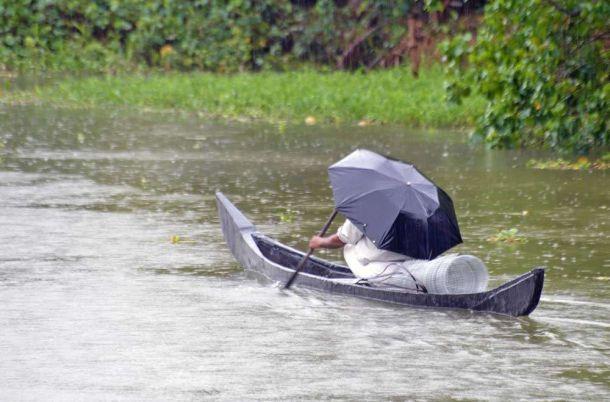 India, Kerala, Cochin, waterways rainswept canoe